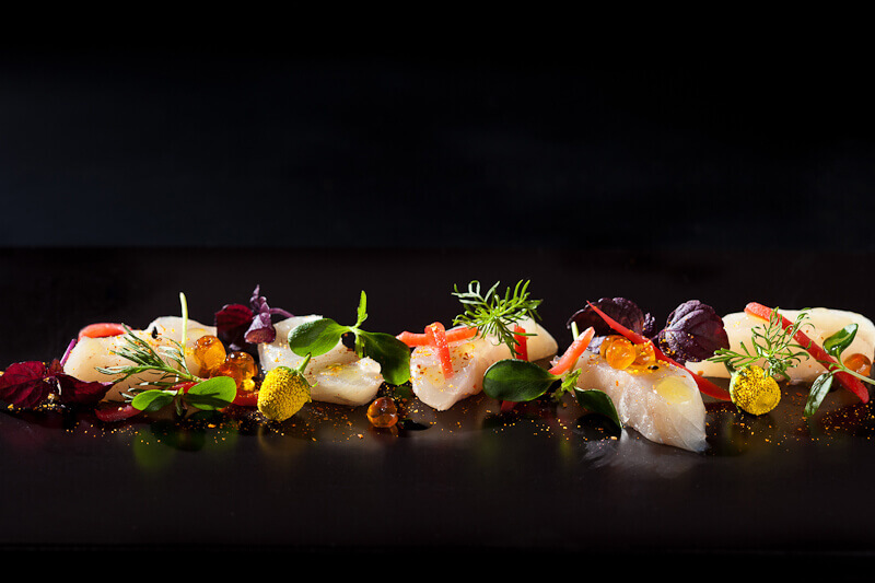 Pretty fish dish against a black backdrop with artificial light | insimoneskitchen.com