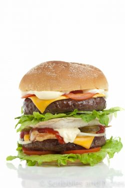 Big and good looking hamburger stacked high on white background