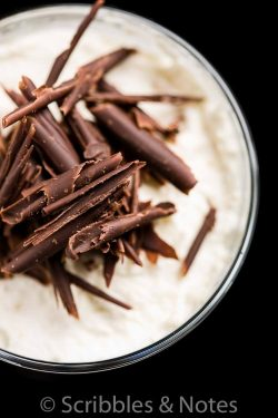 Closeup of the top of chocolate trifle with chocolate shavings and cream on top